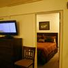 "Unit 427-View from Living Area into Private Bedroom with King Bed-32"" Flat Screen TV"