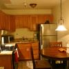 Unit 427-Kitchen with Modern Appliances, including Range, Refrigerator with Icemaker, Microwave, Toaster, and Blender